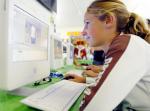 teenager at computer