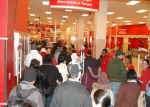 Black Friday shoppers enter Target (green)