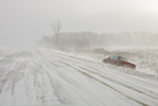 car on snowy roadside