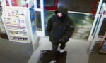 pharmacy robbery suspect