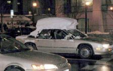 snow on roof of car