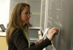 teacher-at-chalkboard-crop-green
