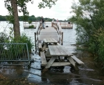flooded fishing dock bridge minnesota green