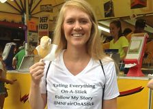 Mandy Colten with one of the 100-plus food items on a stick that she has consumed at the Minnesota State Fair.