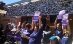 Home health workers celebrate the vote in favor of unionizing on Aug. 26, 2014.