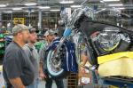 workers_examine_bike