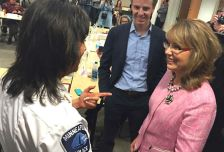Minneapolis Police Chief Janee Harteau, left, greets former Rep. Gabby Giffords, in Minneapolis on Oct. 20, 2014.