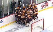 Gopher women's hockey team celebrates a 2-1 OT victory over Wisconsin on Oct. 18, 2014