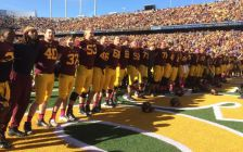 Gopher football players celebrate homecoming victory over Purdue on Oct. 18, 2014.