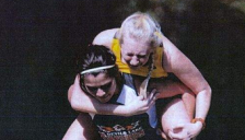 home page thumbnail: devils lake cross country runner carrying other
