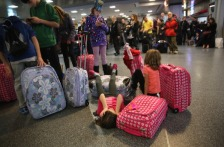 Travelers gather at airport for Thanksgiving weekend flights.