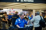 TSA agent directs passengers in security line.
