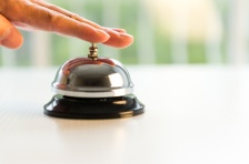 A hand ringing a bell