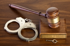 Handcuffs and a gavel.