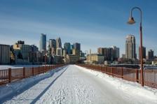 A snowy Stone Arch Bridge in Minneapolis.