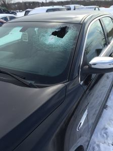 The rock smashed through the windshield and hit the driver in the chest.