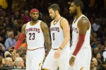 Cleveland Cavaliers players LeBron James, Kevin Love and Kyrie Irving