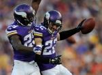 Vikings defensive backs Xavier Rhodes and Harrison Smith