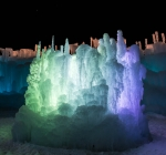 ice castle lit at night green