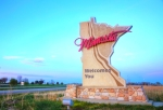 A 'Welcome to Minnesota' sign.