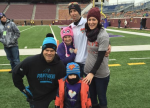 Greg Olsen with Smith family