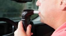 A man taking a breathalyzer test.
