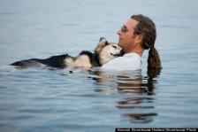 o-MAN-DOG-LAKE-SUPRERIOR-PHOTO-570