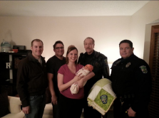 Angela Reinders with baby and Eagan police