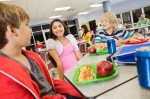 photo of kids eating fruit in school lunch