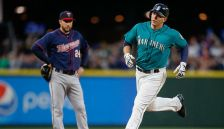 Logan Morrison blasts a solo-home run off Phil Hughes in the fifth inning of Seattle's series opening victory.