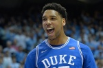 CHAPEL HILL, NC - MARCH 07:  Jahlil Okafor #15 of the Duke Blue Devils reacts after scoring against the North Carolina Tar Heels during their game at the Dean Smith Center on March 7, 2015 in Chapel Hill, North Carolina.  (Photo by Grant Halverson/Getty Images)