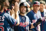 Brian Dozier #2 of the Minnesota Twins celebrates after scoring during the third inning against the Cleveland Indians at Progressive Field on May 9, 2015 in Cleveland, Ohio. (Photo by Jason Miller/Getty Images)