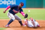 CLEVELAND, OH -  MAY 10: Shortstop Danny Santana #39 of the Minnesota Twins drops the throw as Jason Kipnis #22 of the Cleveland Indians steals second during the second inning at Progressive Field on May 10, 2015 in Cleveland, Ohio. (Photo by Jason Miller/Getty Images)  *** Local Caption *** Danny Santana; Jason Kipnis
