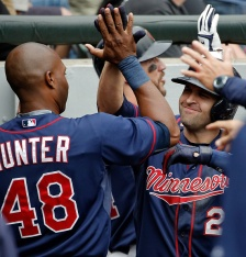 CHICAGO, IL - MAY 24: Brian Dozier #2 of the Minnesota Twins is congratulated by Torii Hunter #48 after hitting a three run home run against the Chicago White Sox during the seventh inning on May 24, 2015 at U.S. Cellular Field in Chicago, Illinois. (Photo by Jon Durr/Getty Images)