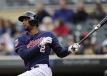 MINNEAPOLIS, MN - MAY 15: Aaron Hicks #32 of the Minnesota Twins hits a walk-off single against the Boston Red Sox during the eleventh inning of the game on May 15, 2014 at Target Field in Minneapolis, Minnesota. The Twins defeated the Red Sox 4-3 in eleven innings. (Photo by Hannah Foslien/Getty Images)