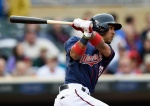 MINNEAPOLIS, MN - MAY 7: Eddie Rosario #20 of the Minnesota Twins hits an RBI single against the Oakland Athletics during the fourth inning of the game on May 7, 2015 at Target Field in Minneapolis, Minnesota. The Twins defeated the Athletics 6-5. (Photo by Hannah Foslien/Getty Images)