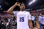 INDIANAPOLIS, IN - APRIL 06:  Jahlil Okafor #15 of the Duke Blue Devils celebrates after defeating the Wisconsin Badgers during the NCAA Men's Final Four National Championship at Lucas Oil Stadium on April 6, 2015 in Indianapolis, Indiana. Duke defeated Wisconsin 68-63.  (Photo by Streeter Lecka/Getty Images)
