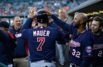 DETROIT, MI - MAY 13:  Joe Mauer #7 of the Minnesota Twins celebrates scoring a run in the third inning with Aaron Hicks #32 and other teammates while playing the Detroit Tigers at Comerica Park on May 13, 2015 in Detroit, Michigan.  (Photo by Gregory Shamus/Getty Images)