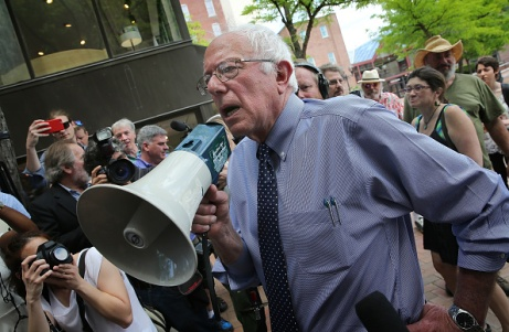 CONCORD, NH - MAY 27:  Democratic presidential candidate and U.S. Sen. Bernie Sanders (I-VT) speaks to an overflow crowd through a megaphone after a campaign event at the New England College May 27, 2015 in Concord, New Hampshire. Sanders officially declared his candidacy yesterday and will run as a Democrat in the presidential election and is former Secretary of State Hillary Clinton's first challenger for the Democratic nomination.  (Photo by Win McNamee/Getty Images)
