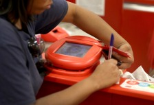 MIAMI, FL - DECEMBER 19:  A customer signs a credit card statement next to a scanner in a Target store on December 19, 2013 in Miami, Florida. Target announced that about 40 million credit and debit card accounts of customers who made purchases by swiping their cards at terminals in its U.S. stores between November 27 and December 15 may have been stolen.  (Photo by Joe Raedle/Getty Images)