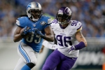 DETROIT, MI - DECEMBER 14: Joique Bell #35 of the Detroit Lions tries to outrun the tackle of Brian Robison #96 of the Minnesota Vikings during the third quarter at Ford Field on December 14, 2014 in Detroit, Michigan. (Photo by Gregory Shamus/Getty Images)