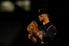 DENVER, CO - MAY 6:  First baseman Justin Morneau #33 of the Colorado Rockies adjusts his glove between pitches during the ninth inning against the Arizona Diamondbacks at Coors Field on May 6, 2015 in Denver, Colorado. The Diamondbacks defeated the Rockies 5-1. (Photo by Justin Edmonds/Getty Images)