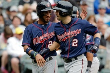 CHICAGO, IL - MAY 24: Brian Dozier #2 of the Minnesota Twins is congratulate by Eddie Rosario #20 after hitting a three run home run against the Chicago White Sox during the seventh inning on May 24, 2015 at U.S. Cellular Field in Chicago, Illinois. (Photo by Jon Durr/Getty Images)