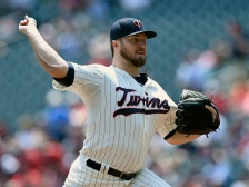 MINNEAPOLIS, MN - MAY 27: Phil Hughes #45 of the Minnesota Twins delivers a pitch against the Boston Red Sox during the first inning of the game on May 27, 2015 at Target Field in Minneapolis, Minnesota. (Photo by Hannah Foslien/Getty Images)