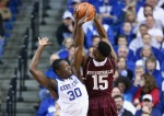LEXINGTON, KY - JANUARY 21:  Julius Randle #30 of the Kentucky Wildcats defends the shot of Davonte Fitzgerald #15 of the Texas A&M Aggies during the game at Rupp Arena on January 21, 2014 in Lexington, Kentucky.  (Photo by Andy Lyons/Getty Images)
