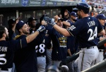MINNEAPOLIS, MN - JUNE 5: Adam Lind #24 of the Milwaukee Brewers celebrates a three-run home run against the Minnesota Twins during the third inning of the game on June 5, 2015 at Target Field in Minneapolis, Minnesota. (Photo by Hannah Foslien/Getty Images)