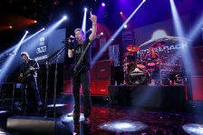 BURBANK, CA - NOVEMBER 18:  (L-R) Ryan Peak, Chad Kroeger and Daniel Adair from the band Nickelback performs at iHeartRadio Theater on November 18, 2014 in Burbank, California.  (Photo by Mike Windle/Getty Images for iHeartMedia)