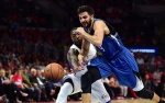 Ricky Rubio of the Minnesota Timberwolves vies for the ball with Nate Robinson of the Los Angeles Clippers during their NBA match at Staples Center in Los Angeles, California on March 9, 2015.  AFP PHOTO / FREDERIC J. BROWN        (Photo credit should read FREDERIC J. BROWN/AFP/Getty Images)