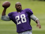LONDON, ENGLAND - SEPTEMBER 26:  Running back Adrian Peterson in action during a Minnesota Vikings training session at the Grove Hotel on September 26, 2013 in London, England.  (Photo by Harry Engels/Getty Images)