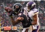 CHICAGO, IL - NOVEMBER 16: Brandon Marshall #15 of the Chicago Bears catches a touchdown pass over Josh Robinson #21 of the Minnesota Vikings during the fourth quarter of a game at Soldier Field on November 16, 2014 in Chicago, Illinois. (Photo by David Banks/Getty Images)